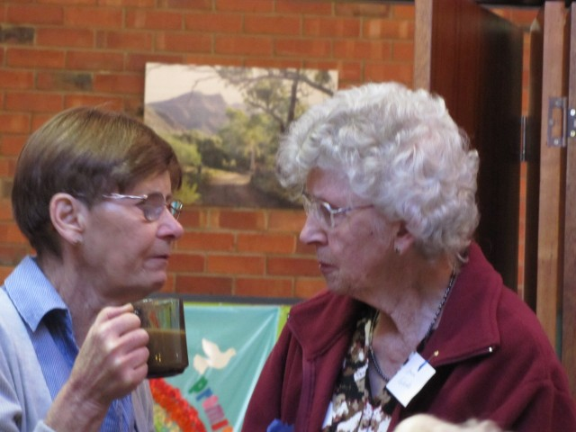 Current member June Parker chatting with former member Joan Roberts